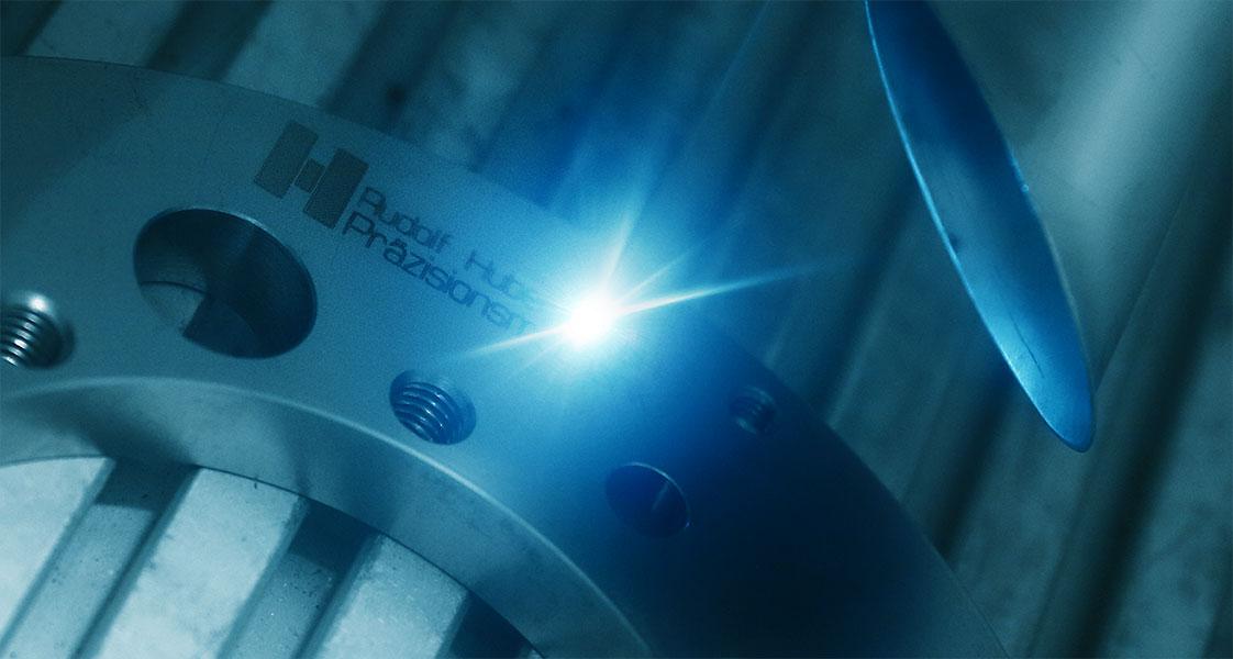 Huber Präzisionsmechanik Laserbeschriftung